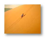 My son Peter, age 4, climbing up the side of the Coral Pink Dunes in Utah