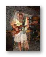 my friend Randy Fabres with one of his guitars: My photo with Photoshop intervention. Randy died 8/18/05...he left a hole in my life and the lives of many.